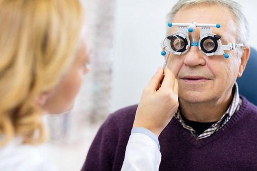 Doctor performing an eye exam