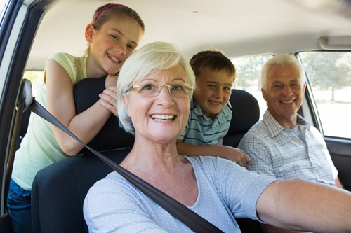 Grandparents in a car with grandkids