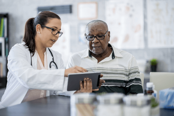 Doctor reviews information with her patient