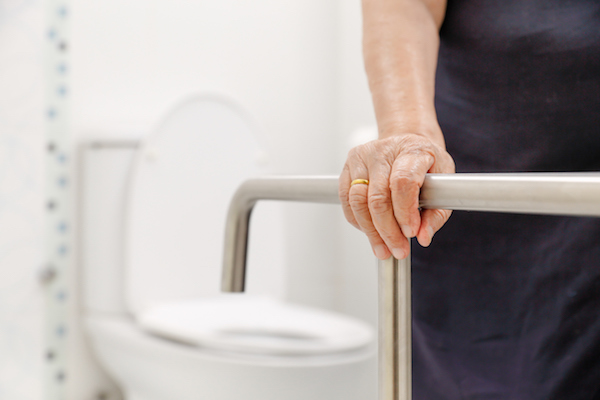 Woman using a grab bar