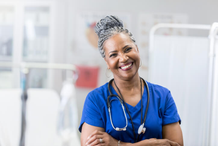 A nurse smiling in the hospital