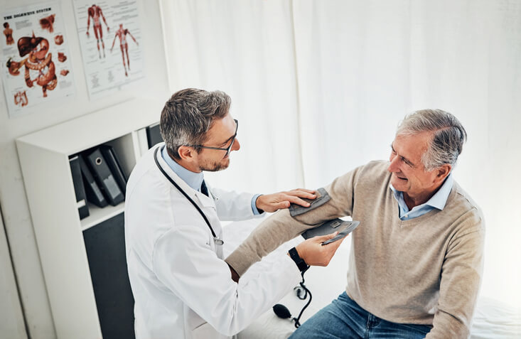 Doctor gives medically necessary physical exam to patient