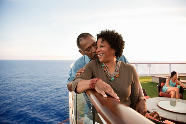 Couple embraces on deck of a cruise ship